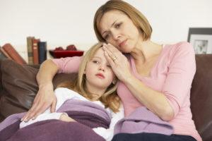 Mother Taking Temperature Of Sick Daughter