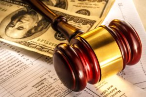 Annual budget, tax form, gavel and dollars